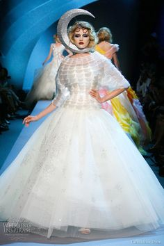 Carnival-like atmosphere on the runway of Christian Dior Fall 2011 couture show, presented by Bill Gaytten, Dior's first couture show without John Galliano. Above, voluminous ball gown (the skirt looks lovely in motion)
