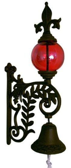 Bell w/ Red Glass Gazing Ball. Great for a garden gate.