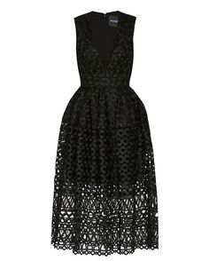Nicholas Midi Ball Lace Dress: A circular lace motif enhances the eye-catching ball gown dress silhouette. Ocean deep V neckline. Zipper closure at back. Lined. In black. Fabric: 100% polyester Lining: 95% polyester/5% spandex Made in Australia.  Model Measurements: Height 5'10 1/2; ...