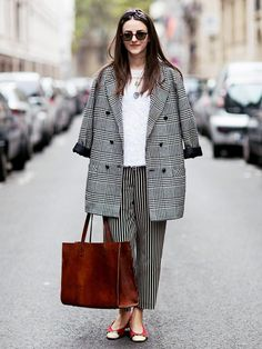 Your Guide to Prints: 34 Street Style Looks to Inspire You via @WhoWhatWear black n' white mixed print pants and outerwear