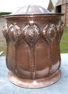 Antiques Atlas - Hammered copper Arts & Crafts coal bin with embossed floral decoration and gently domed lid