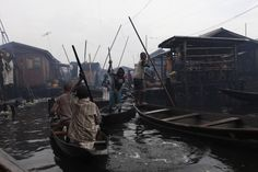 Sept. 27, 2012. People travel on a canoe in the floating slum of Makoko in Lagos, Nigeria.