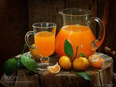 freshly squeezed tangerine juice in a clear pitche by pretty