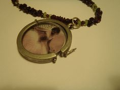 ballerina locket garnet and peridot chips by PunkinPi on Etsy, $30.00