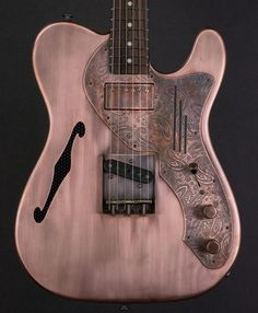 James Trussart Guitars  Antique Copper Paisley Deluxe SteelCaster. Perforated Back. 62 Maple Neck with a Rosewood Fingerboard. Arcane Inc. Tele Bridge and Neck Humbucker Pickups.