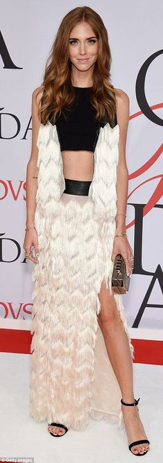 Feel the texture: Chiarra Ferragni looked radiant in a fringe-accented gown while model Co...
