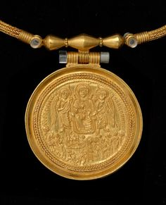 Medallion. Enkolpion with Enthroned Virgin, Nativity, Adoration; and Baptism - Last quarter 6th Century. Gold. Early Byzantine. | Dumbarton Oaks Museum