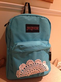 Saw a bag I liked with lace and it was very expensive.. Got this #Jansport #backpack for a much better price! I hot glued a fabric #doily :) #diy