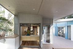 A clever panel-lift door allows the kitchen to engage with the rear covered deck.