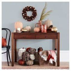 Give your guests a warm welcome with the Harvest Home Accents Entryway Collection from Threshold™. The fall decorations in your entryway will bring instant warmth to your home with their festive yet subtle design, making them pieces you can display all season long. From gold decorative pumpkins to earthenware vases to antler candle holders, your foyer's fall style will be full of decor that you'll be able to use year after year.