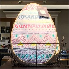 Though not a normal container, this Wire Mesh Easter Egg Basket At Nordstroms sets a tone for the Season, while merchandising egg-shaped throw pillows. Easter Egg Basket, Easter Eggs, Retail Merchandising, Wire Mesh, Wire Baskets, Nordstrom, Throw Pillows, Cushions, Retail