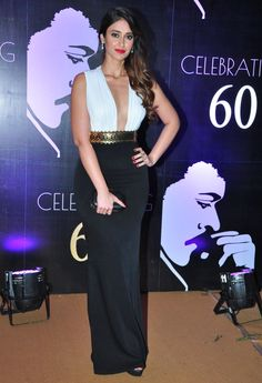 Ileana D'Cruz looked super glam in a Shantanu & Nikhil gown for Chiranjeevi's 60th birthday celebrations last night. She teamed the risqué monochrome evening dress with diamond earrings and a black minaudière. Tousled, side-swept waves were paired with siren red lips and smoky eyes. Perfect for a glamorous night out, no? #HauteStepper