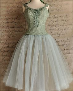 Mint and cocoa woman's tulle skirt. Tutu lined skirt in tea length. Carrie Bradshaw mint green tutu. $185.00, via Etsy.