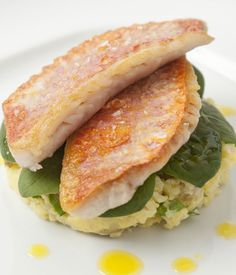 Pan-fried red mullet with baby spinach salad and crushed Caesar new potatoes recipe - This outstanding red mullet recipe from Adam Gray ensures the fish's attractive skin is cooked crisp by dusting the skin-side with flour and pressing down gently while it fries. You needn't have to worry about turning it, as these delicate fillets cook very nicely on one side only.
