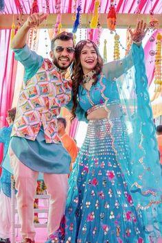 Mirror Work lehenga with splashes of pink paired with a scalloped dupatta with Mirror borders. (C) Sam & Ekta #wittyvows #mirrorworkoutfits #wedding #indianwedding #bride #weddingphotography #bridal #indianbride #weddingseason #floraljewelry #floraljewellery #mehendioutfit #bridetobe #love #mehendi #mehendi #weddingdress #jewellery #weddings #photography Mirror Work Lehenga, Mehendi Outfits, Blue Mirrors, Wedding Season, Bridal Style, Designer Dresses, Wedding Photography, Indian, Bride