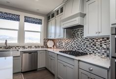 Elegant black, gray and white tile define this kitchen. The Vanessa plan, a new home built by Edge Homes, in the Talus Ridge community. Sarasota Springs, UT.