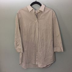 NWOT Stripe Collared Shirt 3/4 Length Sleeves. I bought a larger size for a baggier fit. Lightweight and great for layering. UNIQLO Tops Button Down Shirts