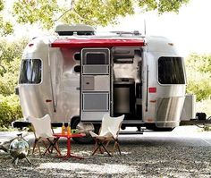 mini airstream trailer - this is what I want for my gypsy blood. now that my kids have moved away from Seattle, I want to travel around the country. I've seen more of Europe than I've seen of the US. My husband isn't sold on the idea, but he did buy a bigger SUV, so he might be coming 'round. (I was not old enough to have a car when most hippies did the flowered VW van thing.)