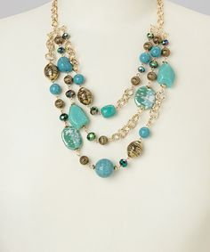 Loving this Turquoise & Gold Triple Strand Bead Bib Necklace on #zulily! #zulilyfinds