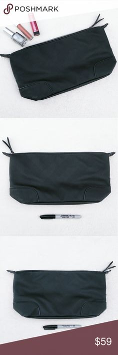 "Burberry Beauty Black Cosmetic Makeup Bag Pouch Large black cosmetic bag by Burberry Beauty  Black with signature Burberry plaid designs embossed in the material.  Has an exposed silver zipper on the top with ""Burberry Beauty"" embossed on the zipper pull.  Lined in plain black.  Has snaps on the side.   Folds flat for easy storage when not filled with items.   Does not come with box.  Has some scuffs and marks on outside, some shown.   Sharpie is to show the scale.   Approx. Measurements…"