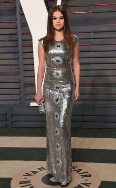 Selena Gomez in a Louis Vuitton gown and Jimmy Choo shoes at the 2016 Vanity Fair Oscar Party on February 28, 2016