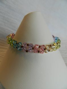 PASTEL RAINBOWS Swarovski crystal bracelet by Changing Seasons. So cute! Will have to make this!