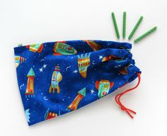 Space Rocket Goody Bags / Birthday Party Favors / Cloth Gift Bags / Fabric Goodie Bags / Treat Bags / 6.25 x 9.5 inches / Set of 5. $21.00, via Etsy.