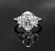 Oval Engagement Ring with side stones ... i LOVE this