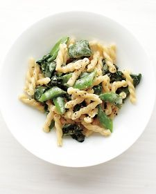 Pasta with basil, snap peas, and spinach.