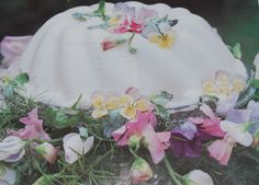 Molded French Cream garnished with edible flowers. Southern Living Magazine (April 1999)