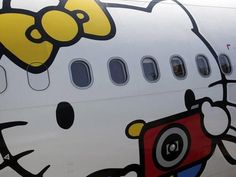 #changetheworldin24hours Goals: Gvt. and Corporate Biz encourage airlines for creative expression. A passenger looks out of an Airbus A330-300 aircraft of Taiwan's Eva Airlines, decorated with Hello Kitty motifs, in Taoyuan International Airport, northern Taiwan, April 30, 2012. Description from teakdoor.com. I searched for this on bing.com/images