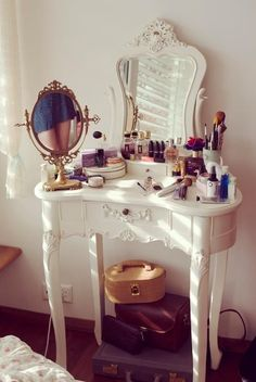 So beautiful and feminine. I adore the gold mirror. #boudoir #vanity