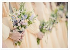 Really interesting selection of flowers -  light yellow bridesmaid dresses and pastel bouquets