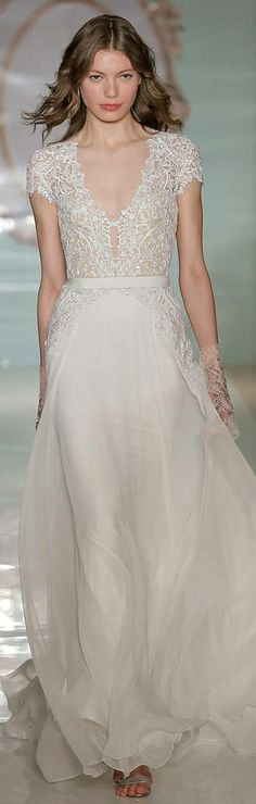 Reem Acra Spring 2015 sheath wedding dress with cap sleeves, v-shaped neckline with keyhole, lace bodice, natural waist, and romantic chiffon skirt