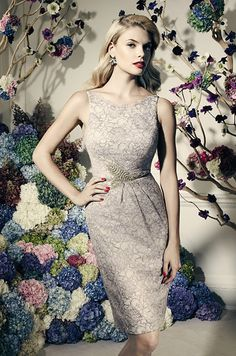 Ultra-feminine all over lace detailing features eye-catching leaf motif beading at waist. Truly Zac Posen, David's Bridal