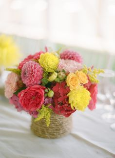 Lovely! Dahlias, ranunculus, solidago, hot pink hydrangea and spray roses