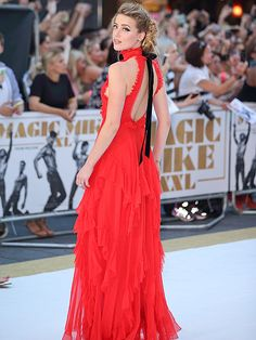 Star Tracks: Wednesday, July 1, 2015 | LADY IN RED | Elsewhere on the Magic Mike XXL carpet, co-star Amber Heard – who recently revealed she re-wrote her character's lines – stuns in a backless red dress.