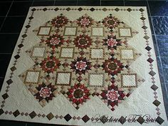 Beautiful! There needs to be something in the squares - maybe grandchildren's names embroidered or something . . .