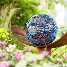 Garden Art creates surprises and adds interest to your plants. This bowling ball, for example, instantly became an eye-catching mosaic sculpture with the addition of some beads and broken glass.