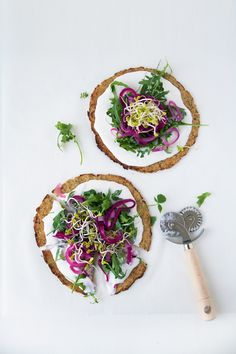 ... herbed cauliflower crusts with whipped goat cheese yoghurt, pickled onions & sprouts ...