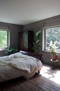 Plants in the bedroom! A Moody Mid-Century Modernist Maisonette | Design*Sponge