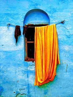 Blue Wall with Orange Sari Photograph~ Drek Selander