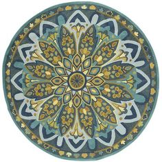 Amla Floral Round Rug.  Makes me want to take up latchhooking again.