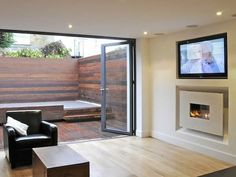 "HOLE IN THE WALL WIDE-SCREEN FIRELINE WITH RECESS AND 50"" plasma - fireplace with tv above plasma tv above gas fire"