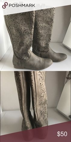 Leather boots Brand new Size 8 medium leather boot's  with beautiful designs,they feel really soft. They We're  to small. crown vintage  Shoes Winter & Rain Boots