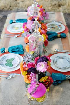 Rich jewel tones and loose succulents. Clearly this is A LOT going on on a long table and we'd modify to fit rounds.