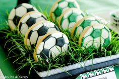 Soccer Party ~ soccer ball cookies are nestled in plastic grass