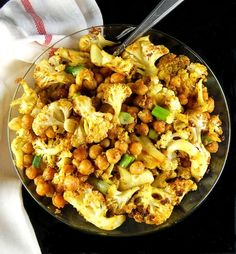A delicious recipe for Roasted Cauliflower and Chickpeas tossed with Indian Spices. Vegan, gluten-free, soy-free and nut-free.