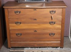 LOVELY CHEST OF DRAWERS WITH METAL HARDWARE AND KEY HOLES. MEASURES 33 INCHES TALL, 43 INCHES WIDE AND 19 INCHES DEEP. NICE CLEAN CONDITION.