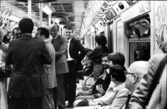Mayor Edward I. Koch riding the subway to Astoria, Queens for a walking tour. 10/12/1978.